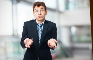 Man-in-suit-shrugging-shoulders-looking-confused